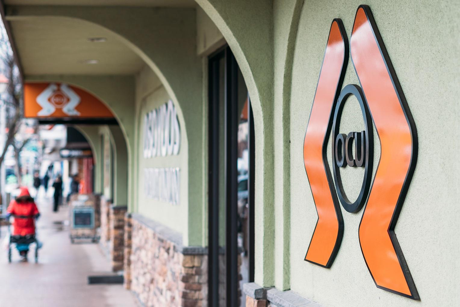 Outside Osoyoos Credit Union Orange and Black Logo digital banking
