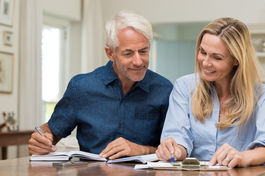 Elderly couple discussing wealth management